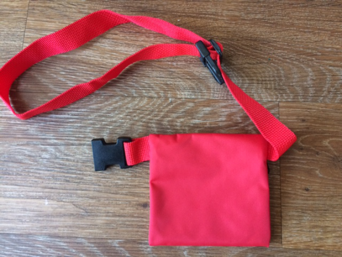 Red purse with waist band clip, supplied plain.